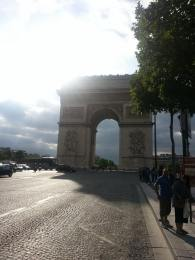 Approaching the Arc de Triomphe for the first time. A magical sun on a magical evening!